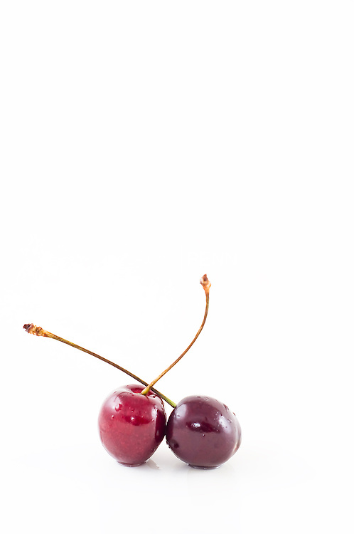 Photo of red cherries on white background