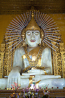 Kyauktawgyi Paya - the main claim to fame here is its 26 feet tall, 900 ton marble Buddha figure carved from one single gigantic slab of marble. It took 10,000 men 13 days to transport it to its site because of its size and weight.