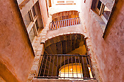 Inner staircase at the Long Traboule (passageway) in old town Vieux Lyon, France (UNESCO World Heritage Site)