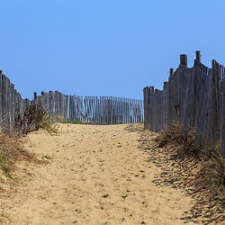 Bethany Beach, DE / USA - April 18, 2015: Fences along the dunewalkway to the beach in Bethany, Delaware.