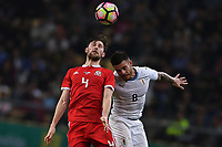 """Ben Davies, top, of Wales national football team heads the ball to make a pass against Nahitan Nandez of Uruguay national football team in their final match during the 2018 Gree China Cup International Football Championship in Nanning city, south China's Guangxi Zhuang Autonomous Region, 26 March 2018.<br /> <br /> Edinson Cavani's goal in the second half helped Uruguay beat Wales to claim the title of the second edition of China Cup International Football Championship here on Monday (26 March 2018). """"It was a tough match. I'm very satisfied with the result and I think that we can even get better if we didn't suffer from jet lag or injuries. I think the result was very satisfactory,"""" said Uruguay coach Oscar Tabarez. Wales were buoyed by a 6-0 victory over China while Uruguay were fresh from a 2-0 win over the Czech Republic. Uruguay almost took a dream start just 3 minutes into the game as Luis Suarez's shot on Nahitan Nandez cross smacked the upright. Uruguay were dealt a blow on 8 minutes when Jose Gimenez was injured in a challenge and was replaced by Sebastian Coates. Inter Milan's midfielder Matias Vecino of Uruguay also fired at the edge of box from a looped pass but only saw his attempt whistle past the post. Suarez squandered a golden opportunity on 32 minutes when Ashley Williams's wayward backpass sent him clear, but the Barca hitman rattled the woodwork again with goalkeeper Wayne Hennessey well beaten."""