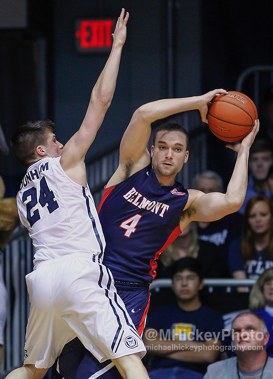 INDIANAPOLIS, IN - DECEMBER 28: Kellen Dunham #24 of the Butler Bulldogs guards Holden Mobley #4 of the Belmont Bruins at Hinkle Fieldhouse on December 28, 2014 in Indianapolis, Indiana. Butler defeated Belmont 67-56. (Photo by Michael Hickey/Getty Images) *** Local Caption *** Kellen Dunham; Holden Mobley