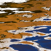 Reflections are created in Canyon Lake as abstract paintings, Canyon Lake State Park, Arizona.