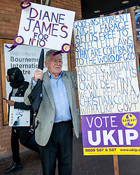 September 17, 2016 - London, England, United Kingdom - Image ©Licensed to i-Images Picture Agency. 17/09/2016. London, United Kingdom. A women in wearing a Hijab walks behind a UKIP supporter holding placards on the second day of the UKIP conference in Bournemouth. Picture by i-Images (Credit Image: © i-Images via ZUMA Wire)