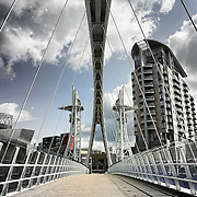The Lowry Footbridge, also known as the Salford Quays Lift Bridge, or Millenium footbridge, crosses the Manchester Ship Canal.