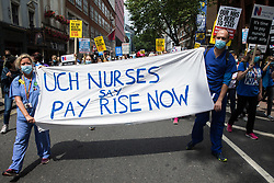 NHS workers and supporters take part in a protest march from University College Hospital (UCH) to Whitehall as part of a national day of action to mark the 73rd birthday of the National Health Service on 3rd July 2021 in London, United Kingdom. The protesters called for fair pay for NHS workers, for better funding of the NHS and for an end to privatisation measures affecting the NHS.