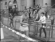 Finish of Dublin City Marathon .25/10/1982  Radio 2, Dublin City Marathon..1982.25.10.1982.10.25.1982.25th October 1982..The Radio 2 sponsored Dublin City Marathon finish at St Stephens Green Dublin..The overall winners were:Men, Gerry Kiernan,Listowel, Kerry. Women, Debbie Mueller,U.S.A. and the first wheelchair competitor Michael O'Rourke..Feeling the strain this competitor walks to the recovery area.