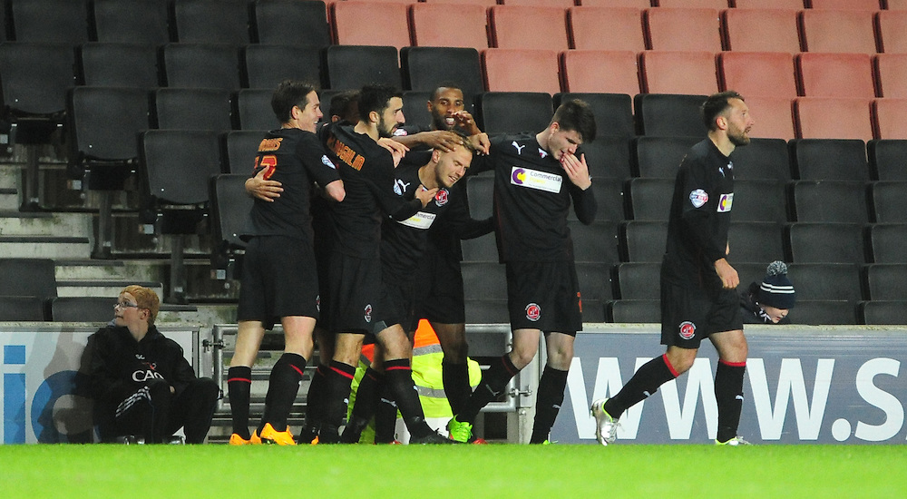 Fleetwood Town's David Ball, centre, celebrates scoring the opening goal with team-mates<br /> <br /> Photographer Chris Vaughan/CameraSport<br /> <br /> Football - The Football League Sky Bet League One - Milton Keynes Dons v Fleetwood Town - Tuesday 21st October 2014 - Stadium:mk - Milton Keynes<br /> <br /> © CameraSport - 43 Linden Ave. Countesthorpe. Leicester. England. LE8 5PG - Tel: +44 (0) 116 277 4147 - admin@camerasport.com - www.camerasport.com