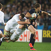 Sean Lamont, Scotland, is tackled during the England V Scotland Pool B match during the IRB Rugby World Cup tournament. Eden Park, Auckland, New Zealand, 1st October 2011. Photo Tim Clayton...