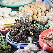 Fresh chicken eggs and herbs for sale at the large and bustling morning market in Phonsavan in northeastern Laos. The people of the region are predominantly of Hmong ethnicity.