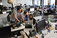 From left to right, Jeff Iden, Thomas Arnold, and Hana Satta, meet at  Satta's desk in the new Facebook headquarters in Menlo Park, CA on Friday, April 20, 2012. Photo by Erin Lubin