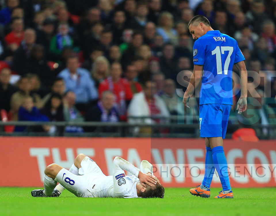 Adam Lallana of England lies holding his face following a collision - England vs. Slovenia - UEFA Euro 2016 Qualifying - Wembley Stadium - London - 15/11/2014 Pic Philip Oldham/Sportimage