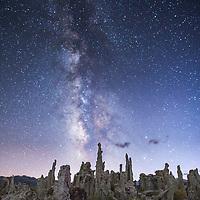 Tufa spires reach to the Milk Way along the edge of Mono Lake. © John McBrayer