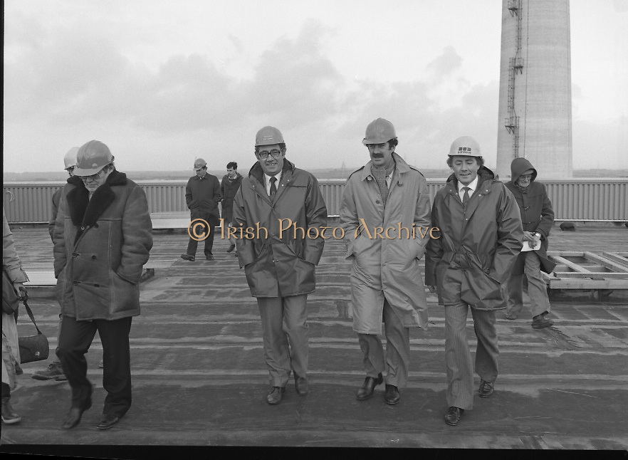 Tanaiste,Dick Spring,Visits Moneypoint..1984..23.11.1984..11.23.1984..23rd November 1984..The Tanaiste and Minister for Energy,Mr Dick Spring,visited Moneypoint Generating Station,Co Clare. He visited the site to view the progress of work there...Pictured moving across a windswept platform were, Mr P.J.Moriarty,CEO,ESB, Mr Pat O'Brien, Station Manager,Tanaiste Dick Spring and Mr Heber McMahon,Site Manager.