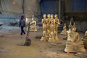 Bronze casts of Buddha statues are made at Phraruangsamai Buddha Factory.