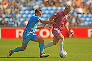 Michael Doyle challenges Andy Cannon during the EFL Sky Bet League 1 match between Coventry City and Rochdale at the Ricoh Arena, Coventry, England on 1 September 2018.