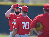 Angels' pitcher Matt Shoemaker talks with Tom Gregorio about his protective hat insert before facing live BP during workouts at the Angels' Spring Training facility in Tempe, AZ on Wednesday, February 22, 2017. (Photo by Kevin Sullivan, Orange County Register/SCNG)