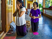 19 NOVEMBER 2017 - HWAMBI, YANGON REGION, MYANMAR:  Women kneel in the portico during mass at Sacred Heart's Catholic Church in Hwambi, about 90 minutes north of Yangon. More than 500 people attend mass at Sacred Heart's, and the sanctuary was full. Catholics in Myanmar are preparing for the visit of Pope Francis. He is coming to the Buddhist majority country November 27-30. There about 500,000 Catholics in Myanmar, about 1% of the population. Catholicism was originally brought to what is now Myanmar more than 500 years ago by Portuguese missionaries and traders.   PHOTO BY JACK KURTZ