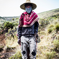 Herdsman Mathibeli Khotola, Lesotho, Africa. Lesotho's rural villagers are cash poor but can own large flocks of sheep, usually grazed on common land or on land leased to them from the King.