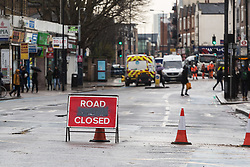 Tooting Broadway is closed as workers clean up and prepare to dig up a large burst water main just yards from the entrance to Tooting Broadway station in South London. London water supply companies are battling a series of burst mains following the recent cold weather brought on by 'The Beast From The East'. London, March 07 2018.