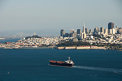California: Golden Gate area, view of ship entering Bay with city skyline.  Photo # 3-casanf78334. Photo copyright Lee Foster.