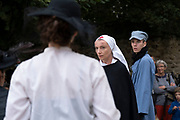 Historical and fictional theatre play acted out on the streets of the town, and with actors wearing traditional costumes for European heritage days on 18th September 2021 in Pont Croix, Brittany, France. Brittany is a peninsula, historical county, and cultural area in the west of France, covering the western part of what was known as Armorica during the period of Roman occupation. It became an independent kingdom and then a duchy before being united with the Kingdom of France in 1532 as a province governed as a separate nation under the crown.