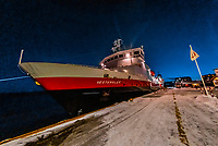 Hurtigruten ship MS Vesteralen docked at Molde, Norway at dusk.