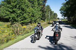 Buck Carson riding beside Shane Masters in the Motorcycle Cannonball coast to coast vintage run. Stage 5 (229 miles) from Bowling Green, OH to Bourbonnais, IL. Wednesday September 12, 2018. Photography ©2018 Michael Lichter.