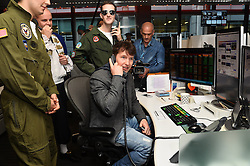 EDITOR'S NOTE. TRADING SCREEN HAS BEEN BLURRED © Licensed to London News Pictures. 27/10/2016. Musician JAMES BLUNT takes part in trading at Bloomberg, encouraging stockbrokers and companies to make donations to their chosen charities. London, UK. Photo credit: Ray Tang/LNP
