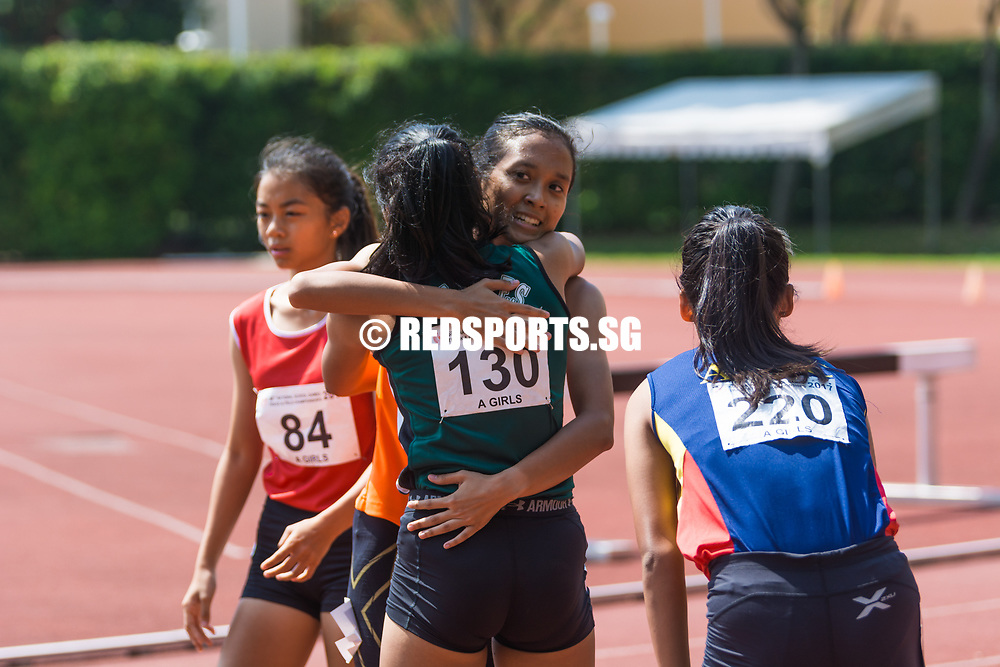 Ismi Zakiah Bte Kashful Anwar (#40) and Tanisha Moghe (#130) share a moment after the race. (Photo © Jerald Ang/Red Sports)