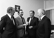 People Of The Year Awards.    (N74).1981..05.05.1981..5th May 1981..Dr Michael Woods TD,Minister for Health & Social Welfare, today presented 73 People of The Year Lapel Emblems at an official ceremony in the New Ireland Assurance Co., Ltd, Dawson Street, Dublin. The lapel emblems were created as a result of recipients of the awards seeking to promote their work by identifying with the awards. It is intended that future recipients of The People Of The Year Awards silver medallions would also receive a lapel emblem...Minister Woods is pictured admiring the new lapel badge in the company of Mr Frank Cahill, Chief Executive, Rehabilitation Institute, Senator Eoin Ryan, Chairman, New Ireland Assurance and Mr Kevin O'Donnell,.Managing Director, New Ireland Assurance