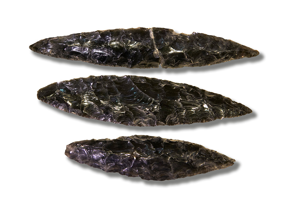 Black obsidian blades. Catalhoyuk Collections. Museum of Anatolian Civilisations, Ankara. Against a white background .<br /> <br /> If you prefer you can also buy from our ALAMY PHOTO LIBRARY  Collection visit : https://www.alamy.com/portfolio/paul-williams-funkystock/prehistoric-neolithic-art.html - Type Catalhoyuk into the LOWER SEARCH WITHIN GALLERY box. Refine search by adding background colour, place, museum etc.<br /> <br /> Visit our PREHISTORIC PLACES PHOTO COLLECTIONS for more  photos to download or buy as prints https://funkystock.photoshelter.com/gallery-collection/Prehistoric-Neolithic-Sites-Art-Artefacts-Pictures-Photos/C0000tfxw63zrUT4