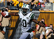 PITTSBURGH, PA - SEPTEMBER 16 :   Santonio Holmes #10 of the New York Jets reacts after scoring a first quarter touchdown against the Pittsburgh Steelers on September 16, 2012 at Heinz Field in Pittsburgh, Pennsylvania.  (Photo by Joe Sargent/Getty Images) *** Local Caption ***Santonio Holmes