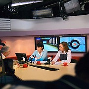 Journalists at the Echo Moscow radio/television station interviews a guest.