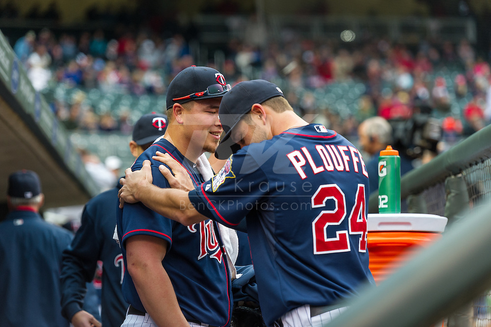 Trevor Plouffe #24 of the Minnesota Twins plays around with starting pitcher Vance Worley #49 before a game against the Boston Red Sox on May 17, 2013 at Target Field in Minneapolis, Minnesota.  The Red Sox defeated the Twins 3 to 2.  Photo: Ben Krause