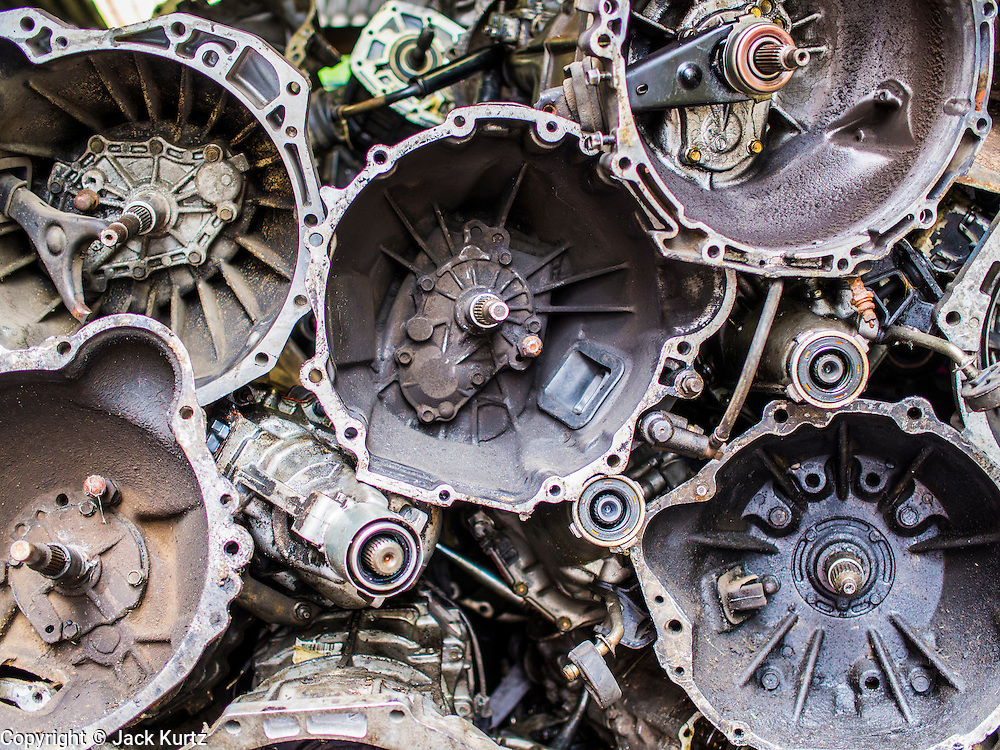 14 AUGUST 2014 - BANGKOK, THAILAND: Used transmission housings for sale in front of a shop in Talat Noi. Talat Noi is a small part of Chinatown that dates back to the Ayutthaya period. It is a melting pot of various cultures and was originally settled by Portuguese,  Vietnamese, Hokkien, Teochew and Hakka Chinese. Now it is mostly small mechanical shops and used car parts.     PHOTO BY JACK KURTZ