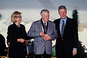 Mexican-American writer and literary critic Luis Leal is presented the National Medal of Arts by President Bill Clinton and First Lady Hillary Clinton during a ceremony on the South Lawn of the White House September 29, 1997 in Washington, DC.