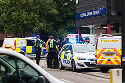 "Kensal Green, London, May 31st 2016. Police in body armoured protective headgear seal off Kensal Green tube station in North West London in what is described as a ""security incident"". PICTURED: Police vehicles outside the  station entrance."