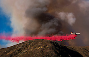 An air tanker drops fire retardant at a wildfire in Lytle Creek, Calif., Tuesday, Aug. 16, 2016. AFP PHOTO / Ringo Chiu