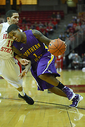 29 December 2011:  Deon Mitchell works to muscle in on Nic Moore during an NCAA mens basketball game between the Northern Illinois Panthers and the Illinois State Redbirds in Redbird Arena, Normal IL
