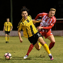 BRISBANE, AUSTRALIA - APRIL 13: Kyusub Bang of Moreton Bay is tackled by Sam Cronin of Olympic FC  during the NPL Queensland Senior Men's Round 4 match between Olympic FC and Moreton Bay Jets at Goodwin Park on April 13, 2017 in Brisbane, Australia. (Photo by Patrick Kearney/Olympic FC)