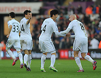 CELE - Swansea City's Ki Sung-Yueng celebrates scoring his sides first goal with team mate Jonjo Shelvey<br /> <br /> Photographer Ashley Crowden/CameraSport<br /> <br /> Football - Barclays Premiership - Swansea City v Sunderland - Saturday 7th February 2015 - Liberty Stadium - Swansea<br /> <br /> © CameraSport - 43 Linden Ave. Countesthorpe. Leicester. England. LE8 5PG - Tel: +44 (0) 116 277 4147 - admin@camerasport.com - www.camerasport.com