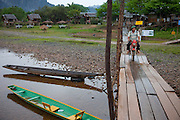 Vang Vieng, Laos. Bamboo bridge over the Nam Song River.