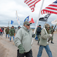 Ronald Daw, left, and Pete Tsinnijinnie, right, lead the veterans walk along AZ-264, to the Navajo Nation Council Chambers in Window Rock on Wednesday.