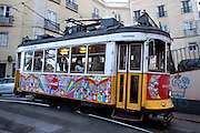 Lisbon's nº28 yellow tram at Escolas Gerais street, on his way to Graça square, as part of the trip through the central, most historic region of the city.