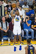 Golden State Warriors guard Patrick McCaw (0) shoots a jumper over the Utah Jazz defense at Oracle Arena in Oakland, Calif., on December 27, 2017. (Stan Olszewski/Special to S.F. Examiner)