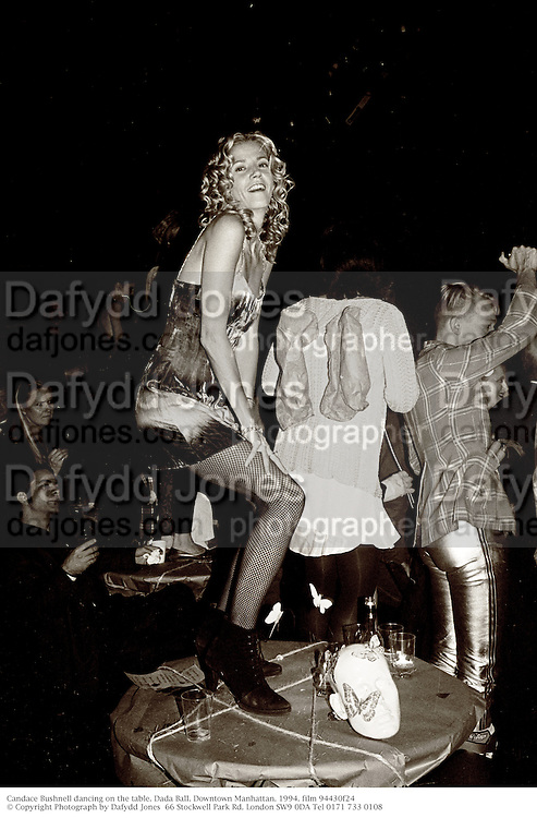 Candace Bushnell dancing on the table. Dada Ball. Downtown Manhattan. 1994. film 94430f24<br />© Copyright Photograph by Dafydd Jones<br />66 Stockwell Park Rd. London SW9 0DA Tel 0171 733 0108