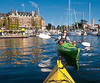 View from a kayak as we paddle the Inner Harbour of Victoria, BC, on a summer afternoon.