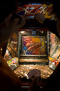 Playing a Penny push/fall game in the amusement arcade at Weston-super-Mare's grand pier.