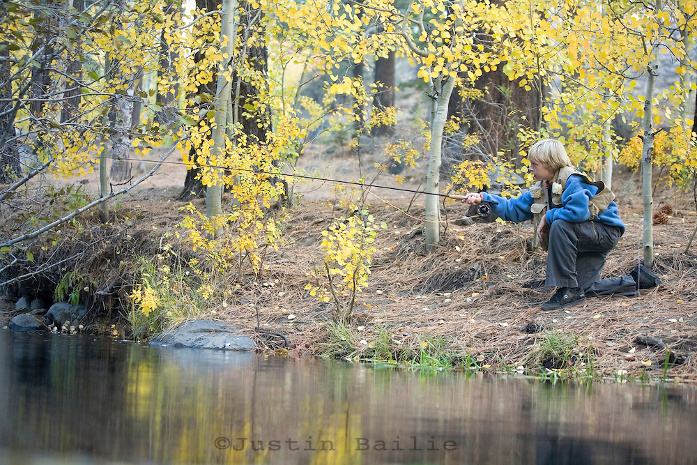 Young boy fly fishing near Reno, NV